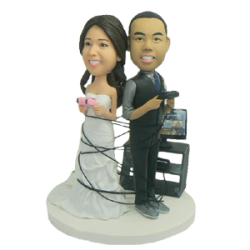 wrapped up in games wedding cake  toppers