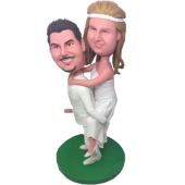 Piggybacking Wedding Cake Topper